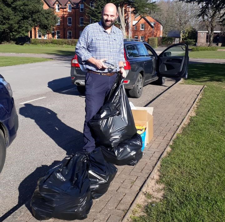 A man with bin bags and boxes