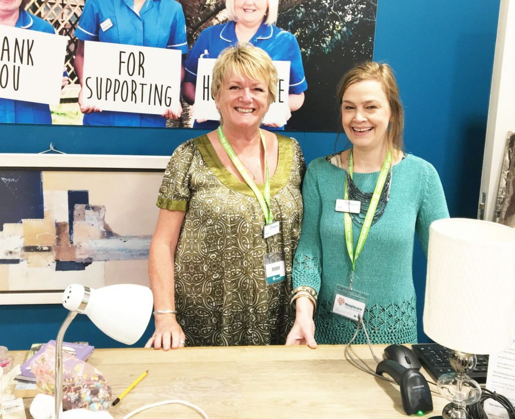 Hospiscare shop volunteer Denise with manager Chris