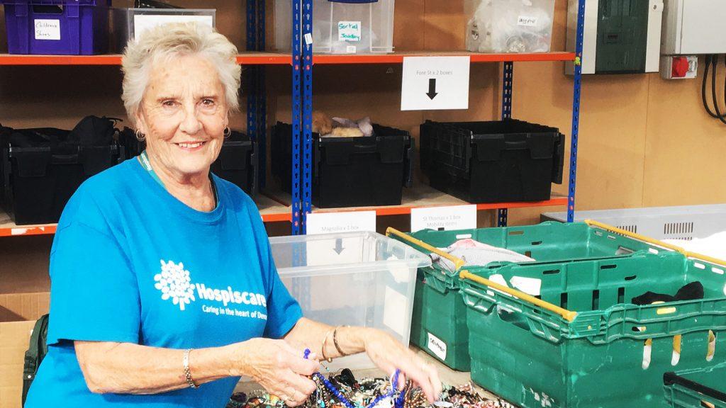 Hospiscare volunteer Di sorting jewellery