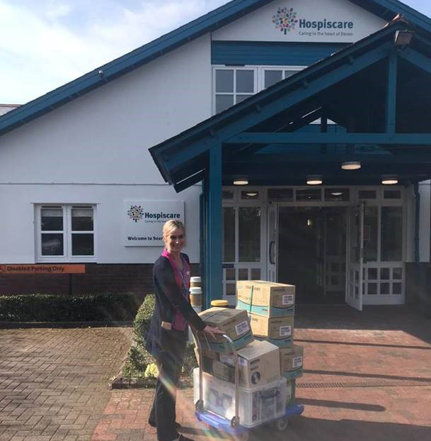 A Hospiscare nurse with boxes of donated PPE
