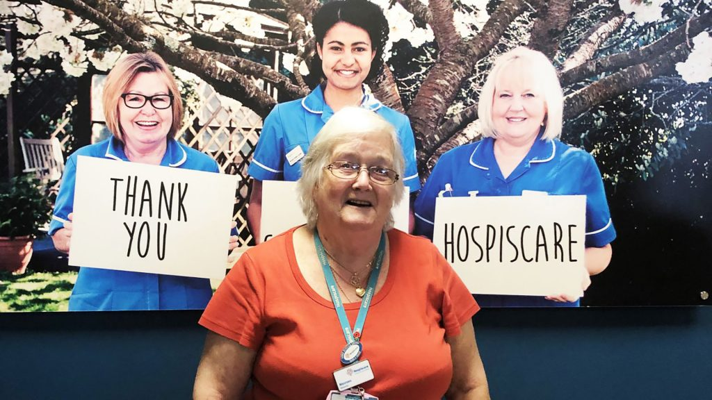 Hospiscare volunteer Maureen wearing an orange top