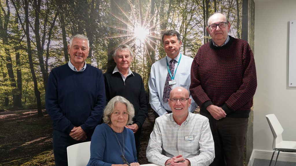 Hospiscare staff signing a merger