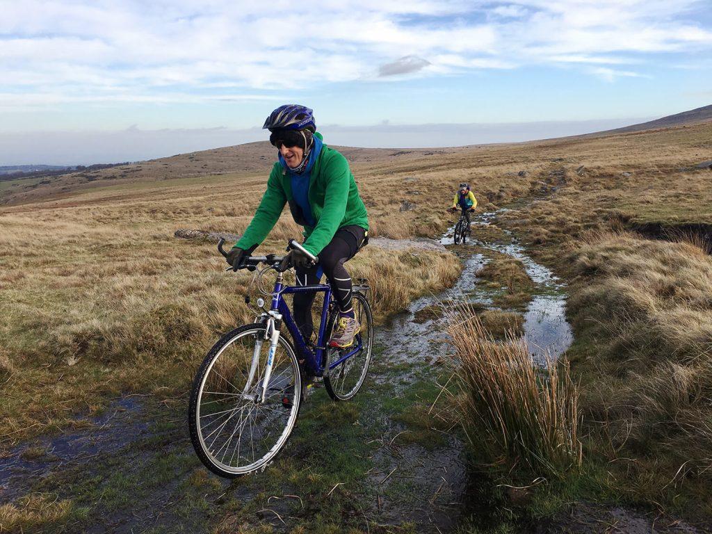 A man mountain biking on Dartmoor