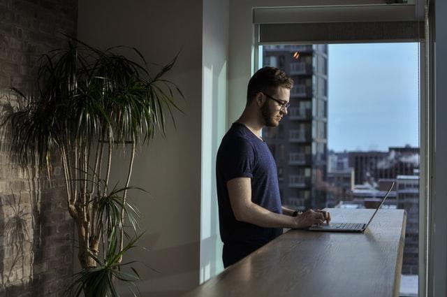 A man at a standing desk