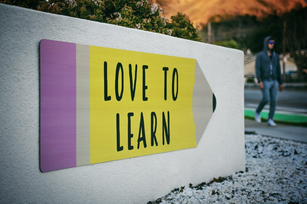 A pencil with love to learn painted on a wall