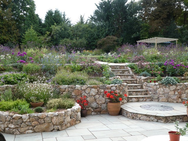 A garden with stone steps