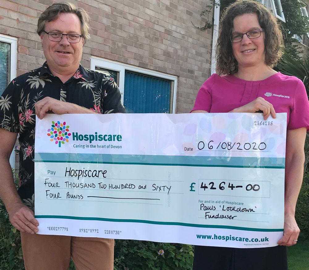 A man and a Hospiscare nurse holding a big cheque for Hospiscare