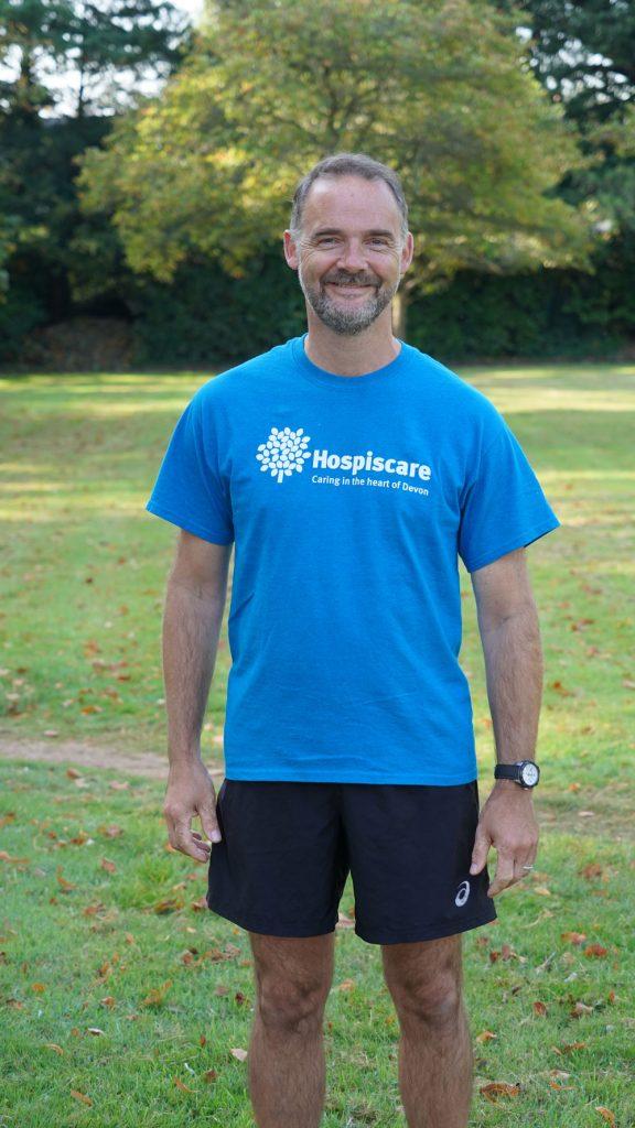 A man wearing a Hospiscare t-shirt