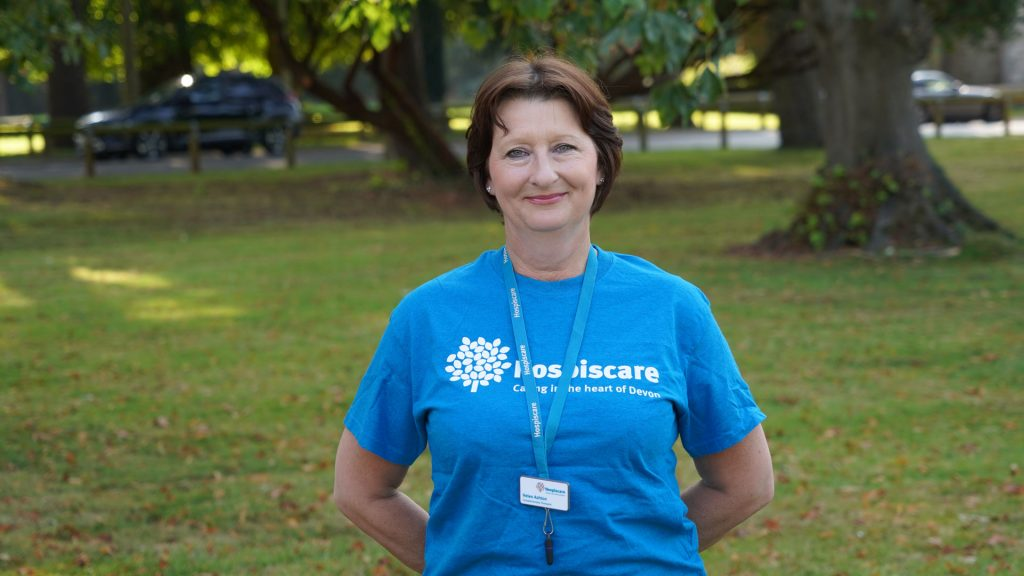 A woman wearing a Hospiscare t-shirt
