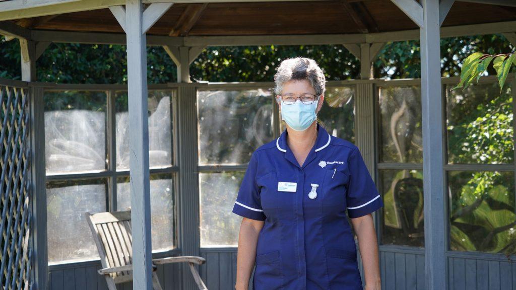 A Hospiscare nurse wearing a face mask