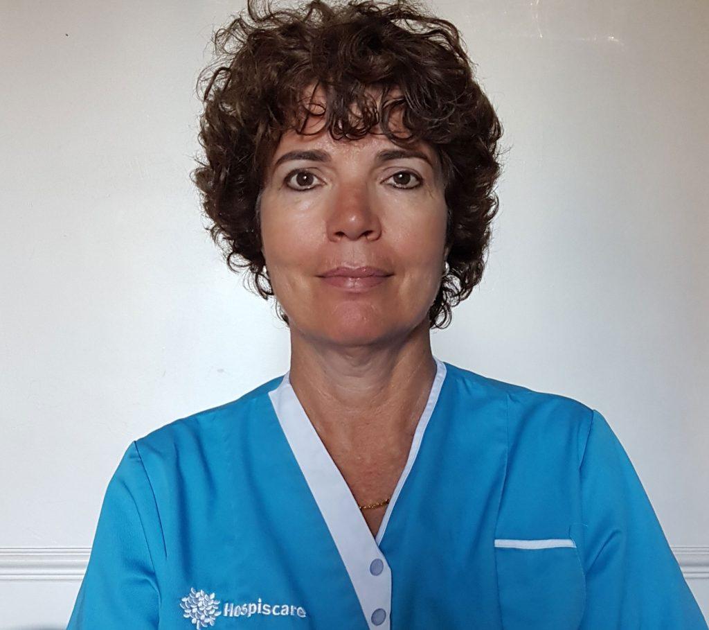 A Hospiscare nurse wearing a blue uniform