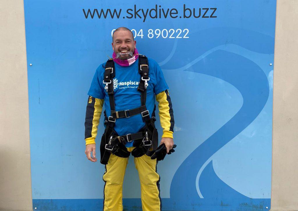 A man wearing skydiving gear