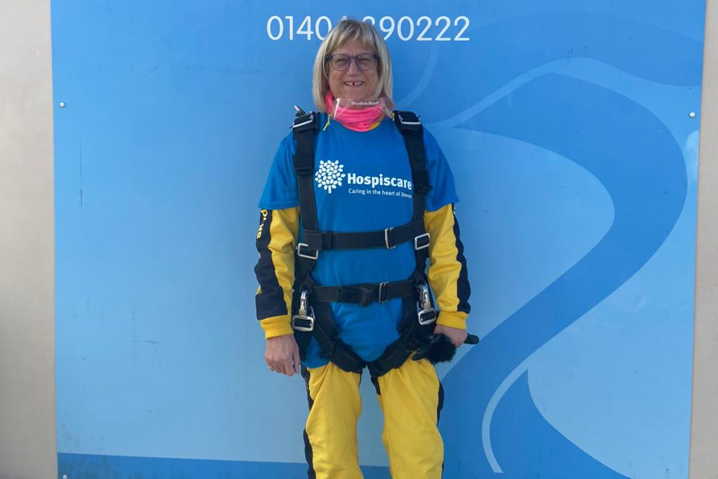 A woman wearing skydiving gear