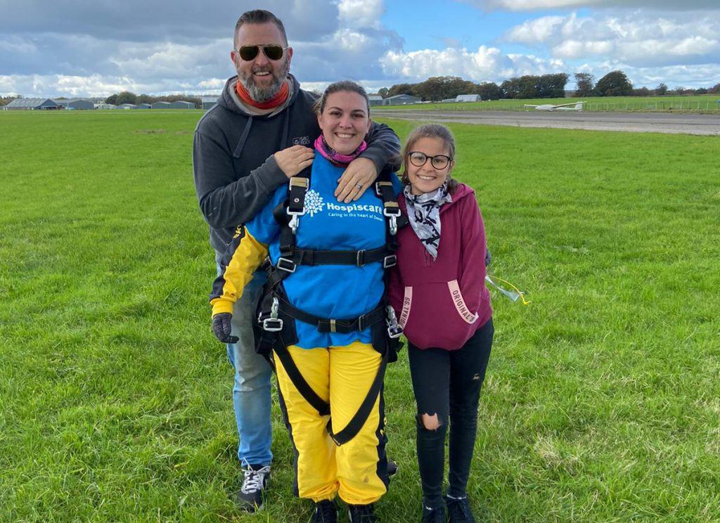 A man, woman and young girl on an airfield