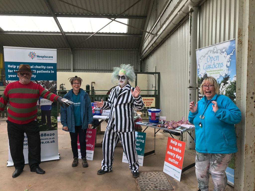 Four people in Halloween costumes promoting Hospiscare charity