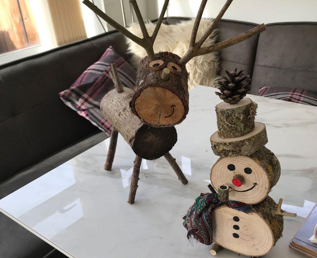 Handmade wooden reindeer and snowman