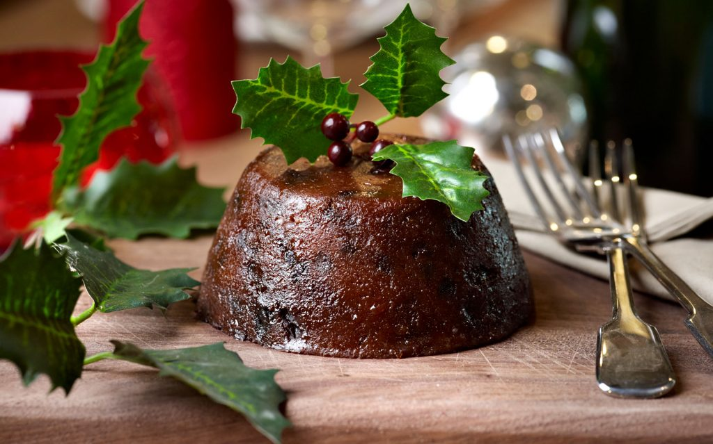 A Christmas pudding topped with holly