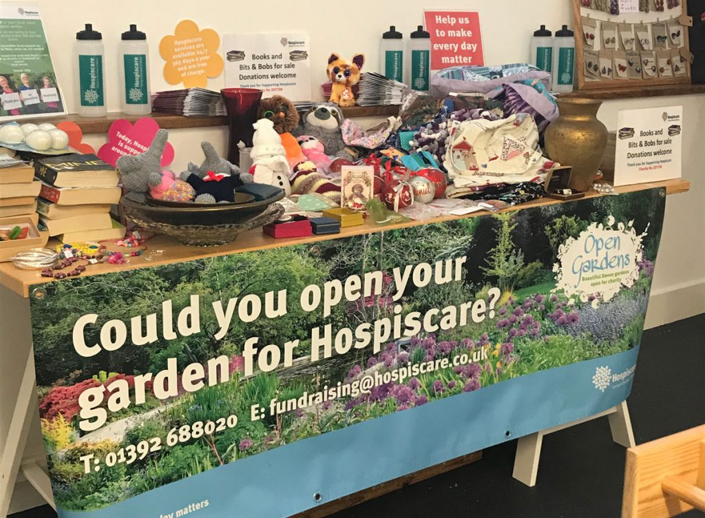 A table top sale with a Hospiscare banner