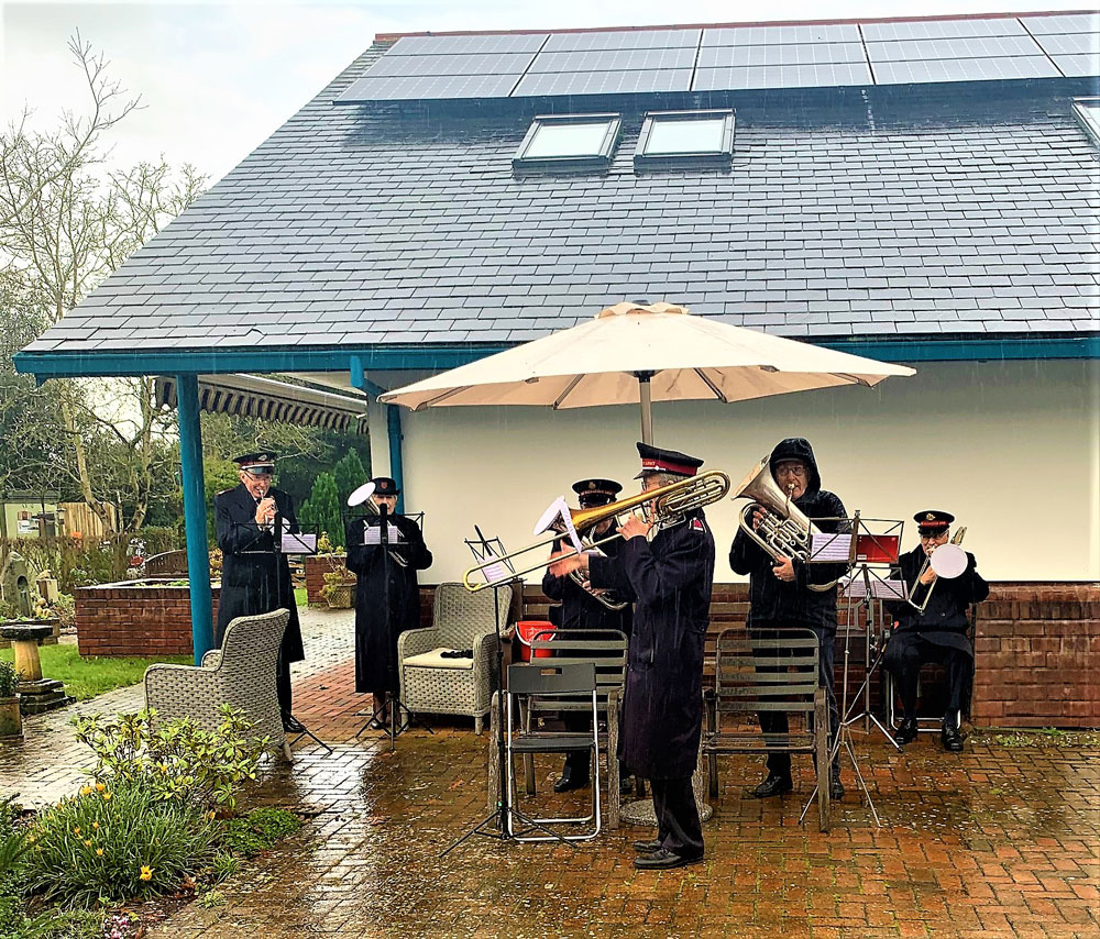 Salvation Army Band playing in the rain