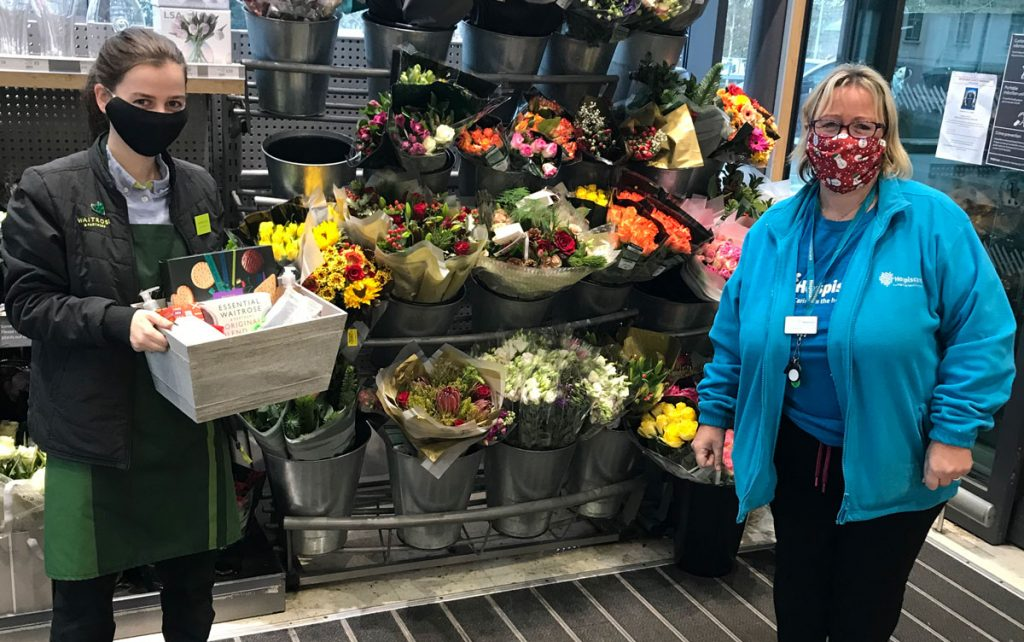 Two women in front of a flower stall at Waitrose