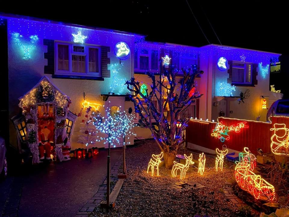 A house lit up with Christmas lights