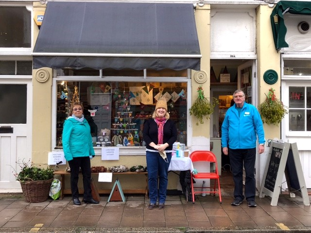 Volunteers in front of a pop-up shop