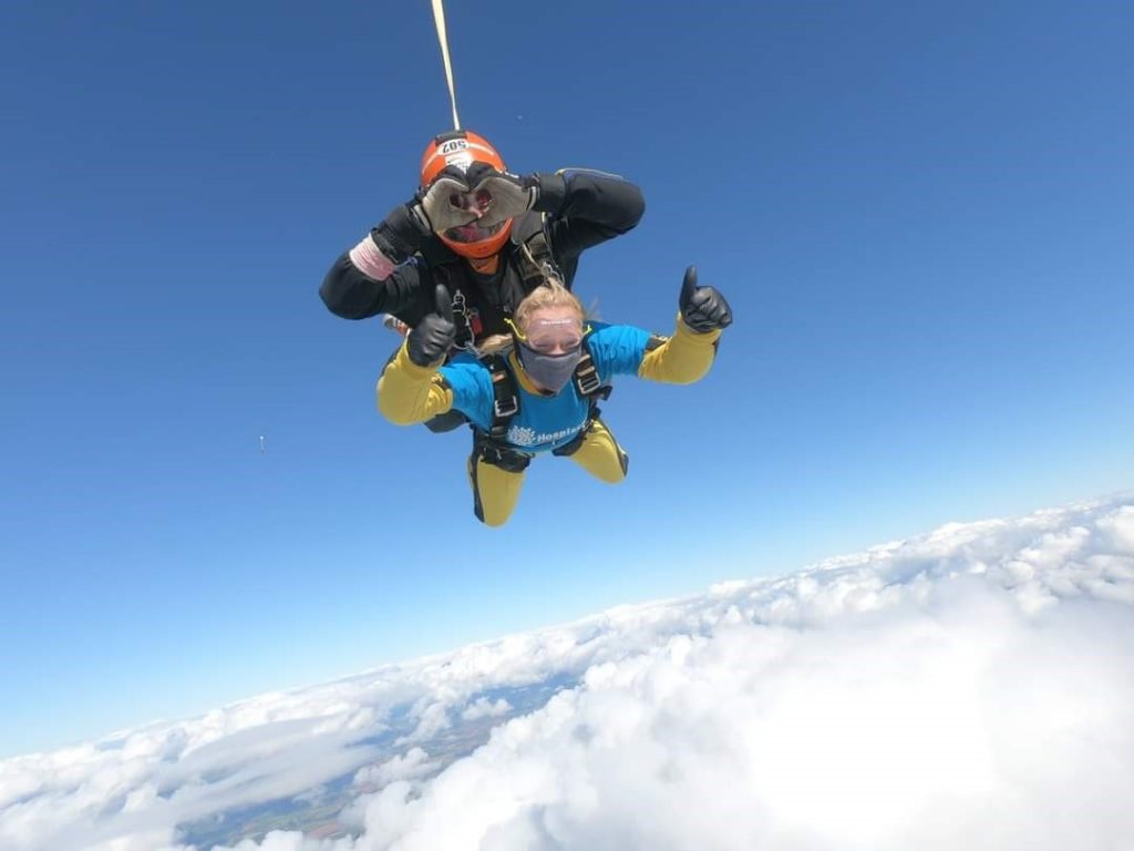 A man and a woman doing a tandem skydive