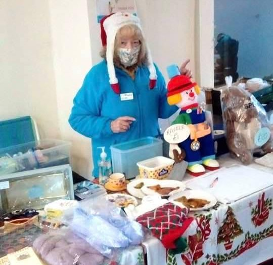 A Hospiscare supporter holding a Christmas craft stall