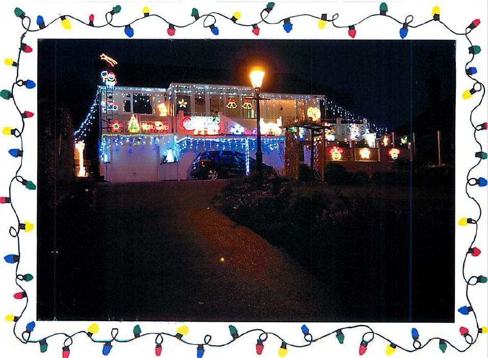 Christmas lights on a house at night time