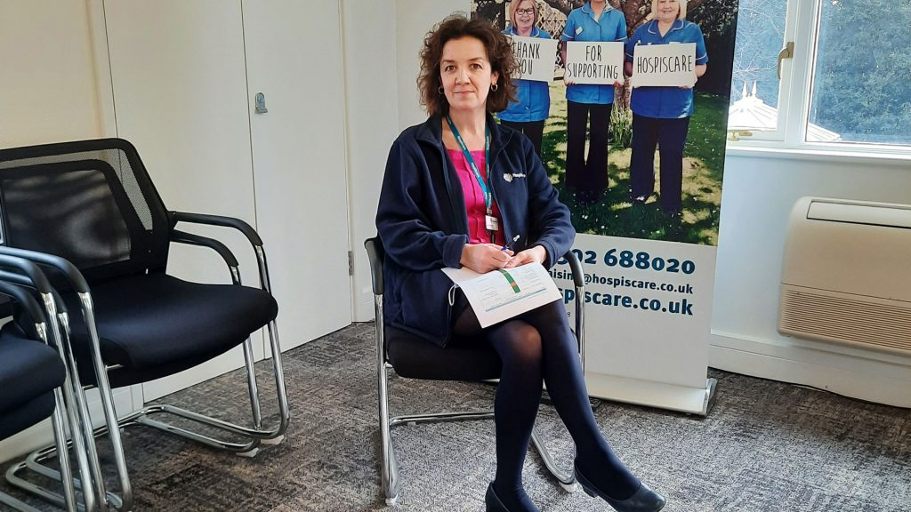 A Hospiscare nurse sitting in a chair