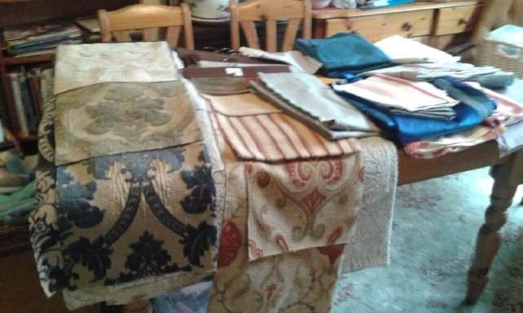A table with swatches of fabric on it
