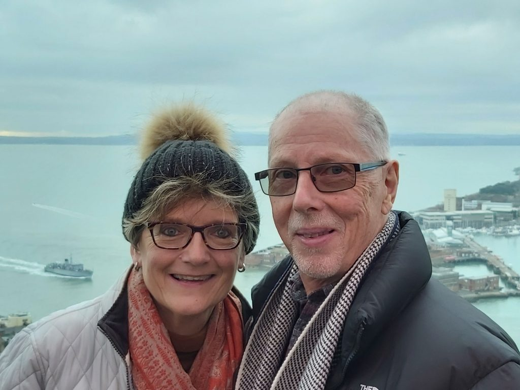 A woman and man at the top of Spinnaker Tower