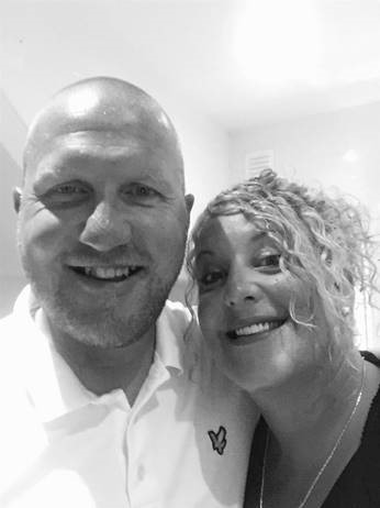 A black and white selfie or a man and woman