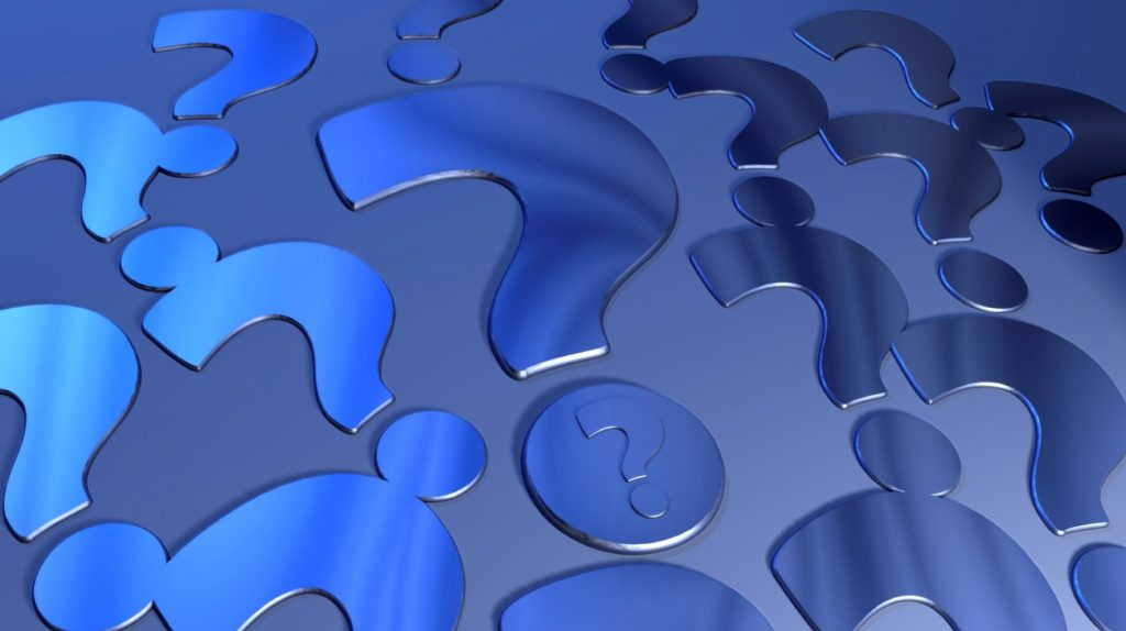 Blue question marks on a blue background