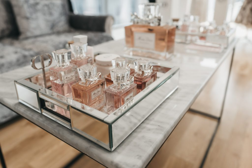 A range of pink perfumes in bottles