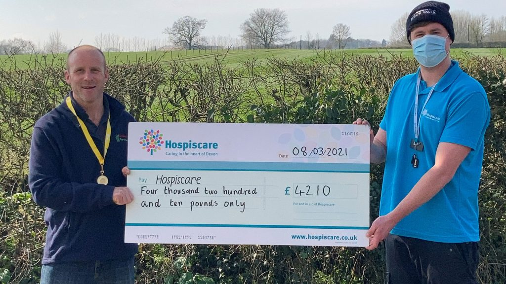 Two men holding a big cheque for Hospiscare