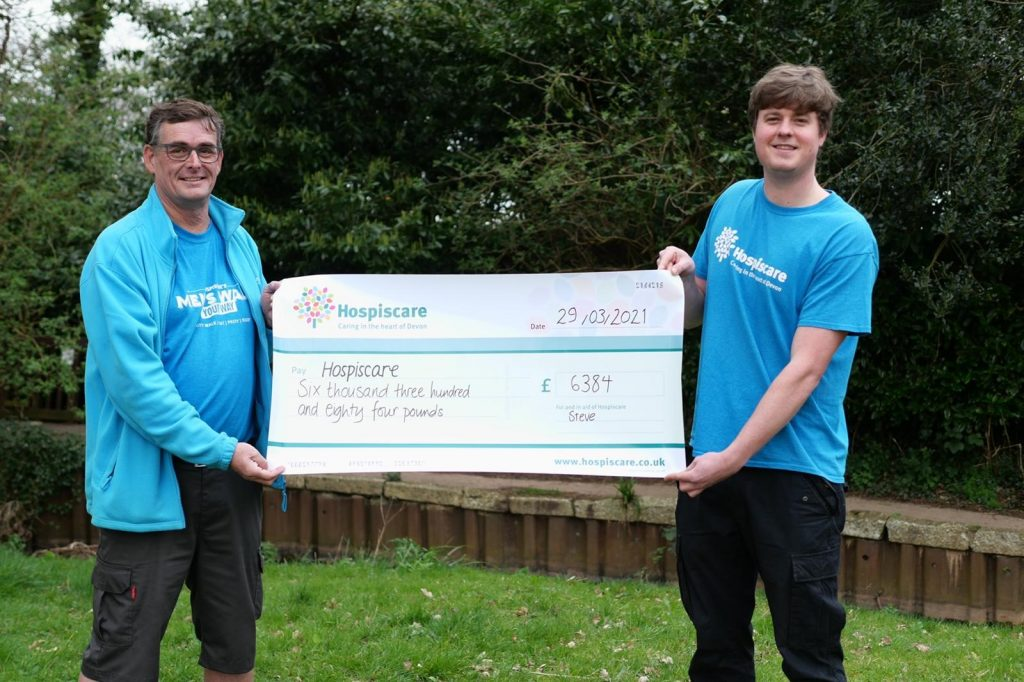 Two men holding a giant cheque for Hospiscare