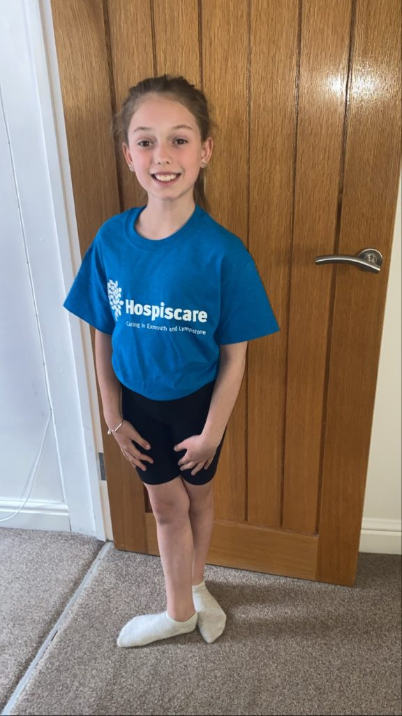 A young girl wearing a Hospiscare t-shirt