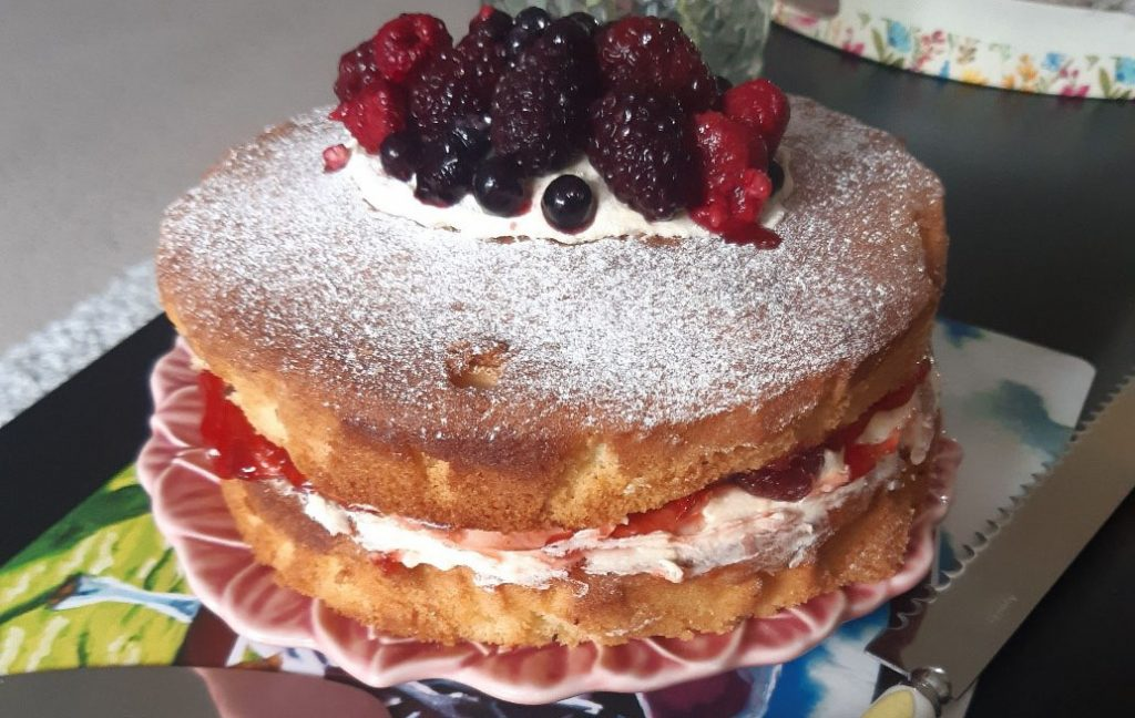 A Victoria sponge with berries on top