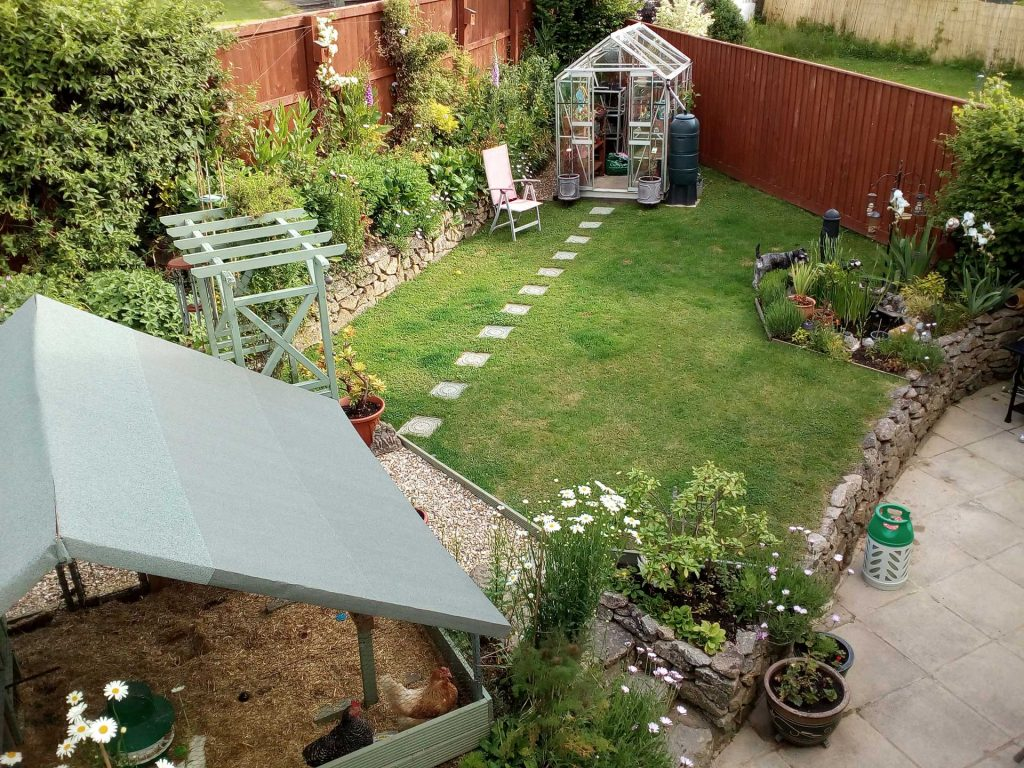 A garden with a hen house pictured from above