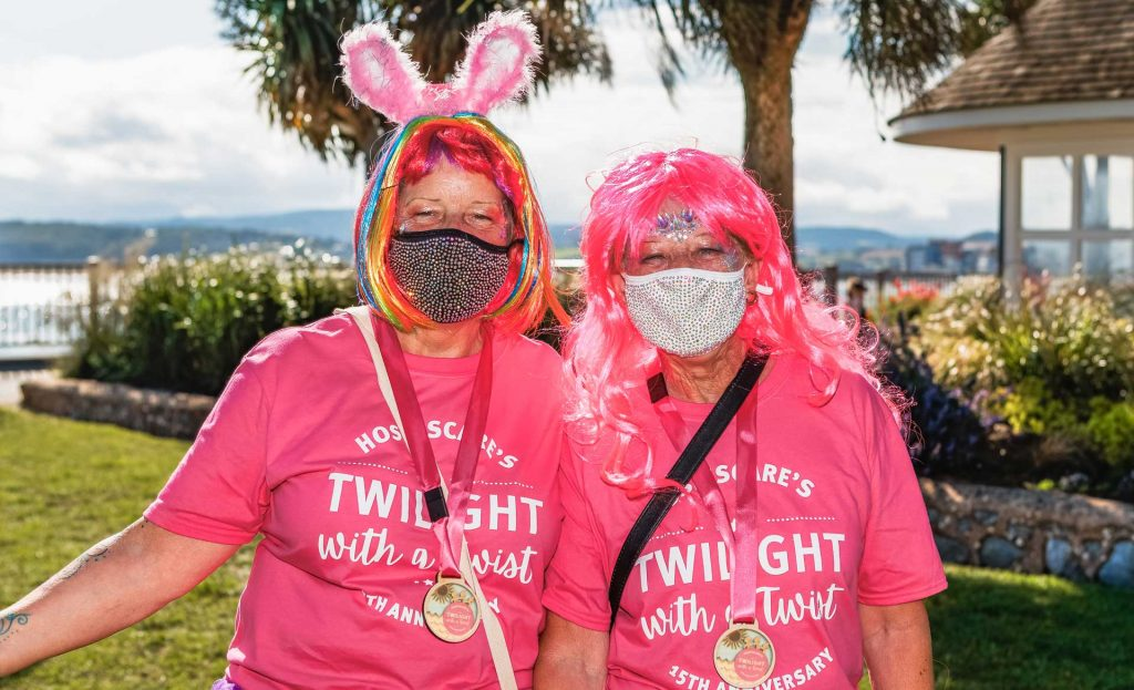 Two people wearing wigs, masks and pink Twilight t-shirts
