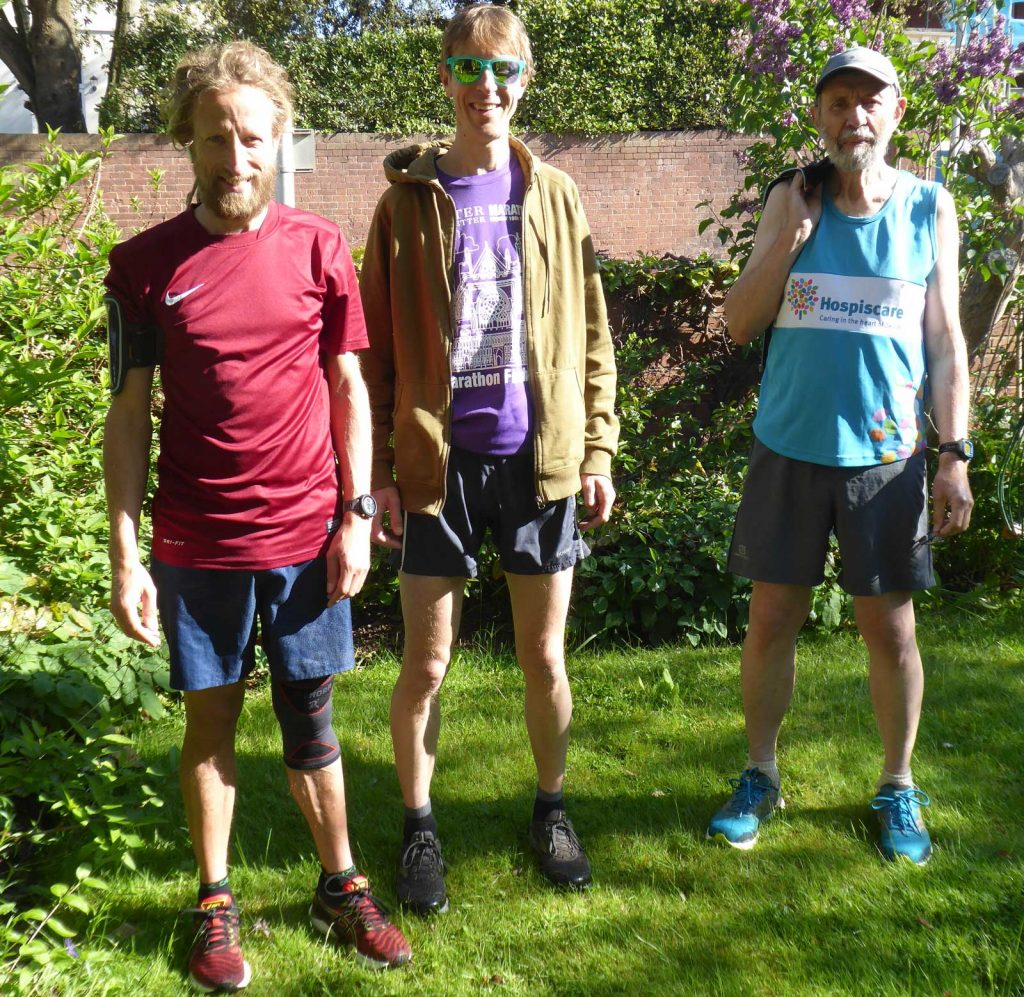 Three men standing outside in summer
