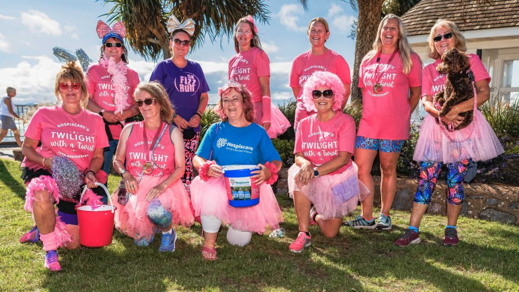 A group of women wearing pink t-shirts on Exmouth seafront