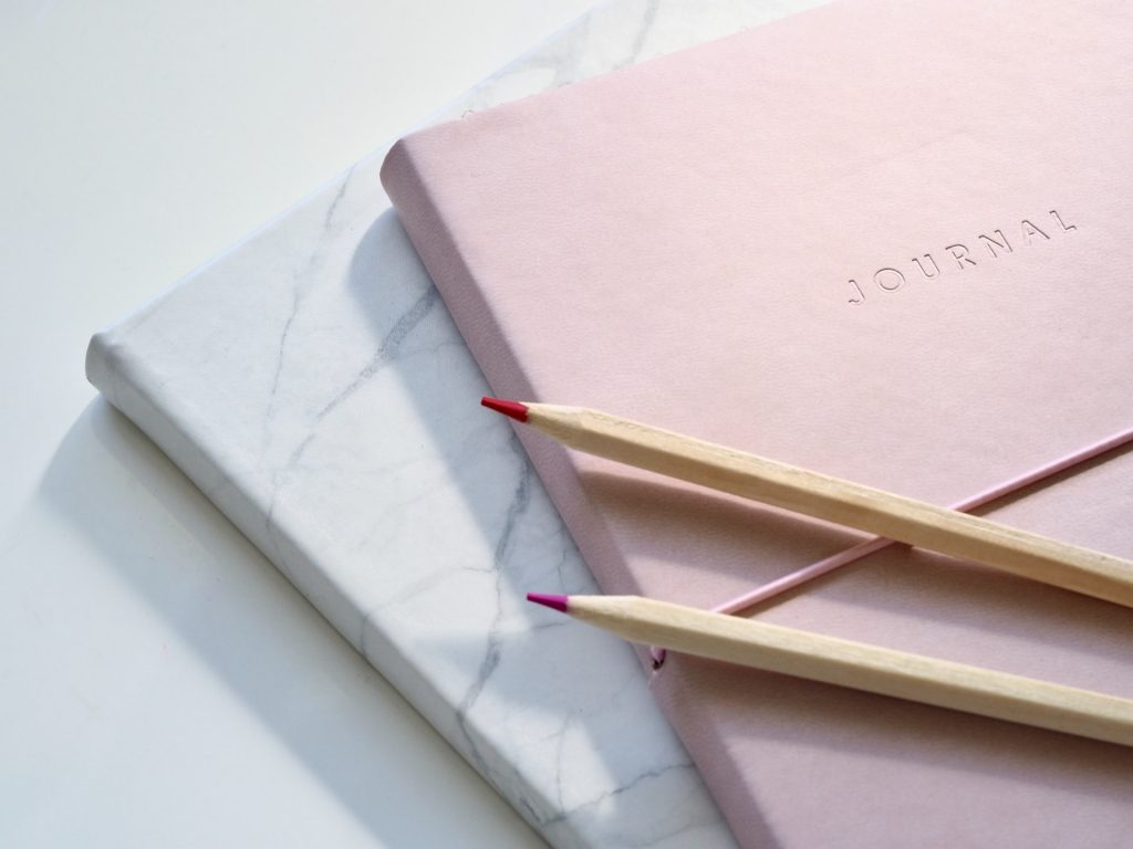 Two journals and two coloured pencils