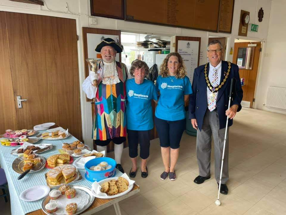 A Town Crier, two women and mayor by a cake table