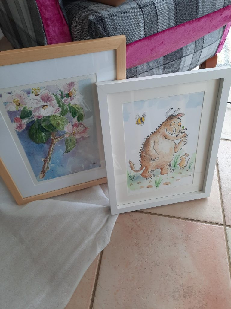 Framed hand painted pictures