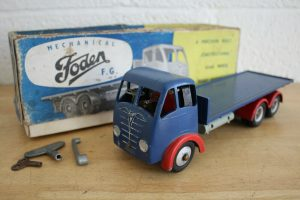 A vintage toy lorry and box