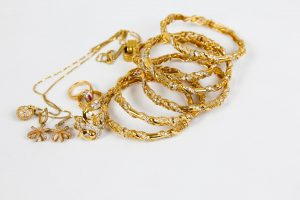 Gold jewellery on a white background